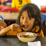 Children in lesson at school by project Cambodian Kids Care. KOH CHANG, THAILAND - FEB 8, 2016: Unidentified children in the classroom at lunch time at school by Royalty Free Stock Images