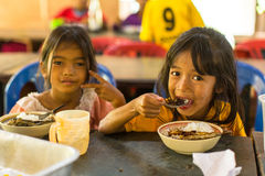 Children in lesson at school by project Cambodian Kids Care. KOH CHANG, THAILAND - FEB 8, 2016: Unidentified children get food at lunch time at school by project Stock Images