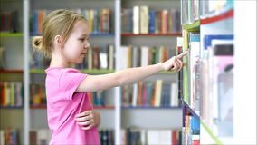 Children in the library stock footage