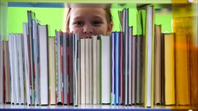 Children in the library stock video footage