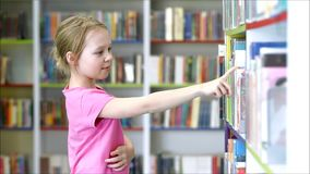 Children in the library stock video