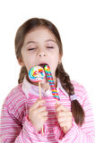 Children licking lollipop Royalty Free Stock Photography
