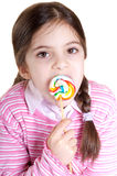 Children licking lollipop Stock Photos
