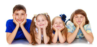 Children lie in four Stock Photography