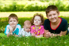 Children lie on the green grass Royalty Free Stock Images