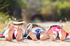Children lie on the ground and eat watermelon Royalty Free Stock Photos