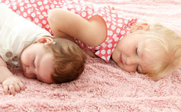 Children lie on the mat Royalty Free Stock Photos