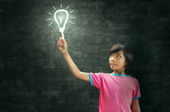 Children lighting and blackboard Royalty Free Stock Photos