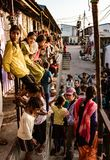 Children line up on stairs, balcony and street to watch foreigne. Kaputhli, India, Artist`s Enclave, Feb 27, 2018 - Children line up on stairs, balcony and Stock Photo