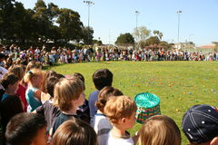 Children Lined up for Egg Hunt Stock Photography