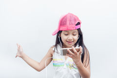 Children listen to music through mobile. Stock Photography