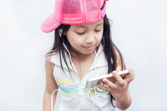 Children listen to music through mobile. Royalty Free Stock Image