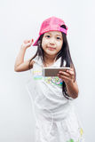 Children listen to music through mobile. Royalty Free Stock Images