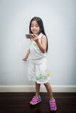 Children listen to music through mobile. Royalty Free Stock Photo
