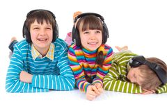 Children listening to music royalty free stock photo
