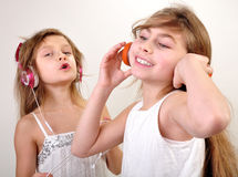 Children listening to music Royalty Free Stock Images