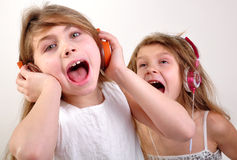 Children listening to music. Portrait of two happy children listening to music Royalty Free Stock Photography