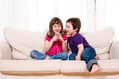Children listening to music Royalty Free Stock Photo