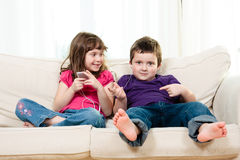Children listening to music Royalty Free Stock Photos