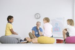 Children listening to paramedic royalty free stock image