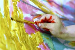 Children little artist painting hand brush. Colorful watercolor art Stock Images