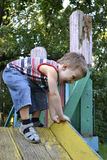 Children. Little boy playing on the old playground Stock Image