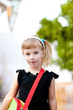 Children little girl going to school with bag Royalty Free Stock Photos