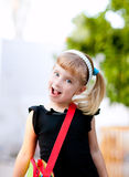 Children little girl going to school with bag Stock Images