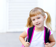 Children little girl going to school with bag royalty free stock photography