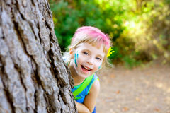 Children little girl happy playing in forest tree Stock Images