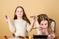 Children little girls make up face. Makeup store. Experimenting with style. Creativity is best makeup skill. Make up. School. Makeup art. Explore moms cosmetics royalty free stock photos