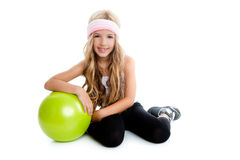 Children little gym girl with green yoga ball. Children gym girl with green yoga ball relaxed Royalty Free Stock Photos