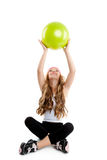 Children little gym girl with green yoga ball. Children gym girl with green yoga ball on pilates exercise Stock Photo