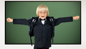 Children. The little children schoolboy gladness stand with green school-board stock images