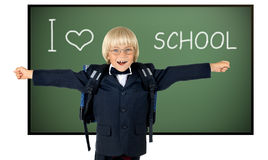 Children. The little children schoolboy gladness stand with green school-board , on white background; isolated stock image