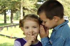 Children little secret. Little boy whisper  little girl children little secret Stock Photos