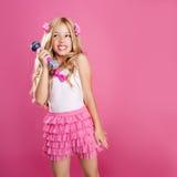 Children little star singer like fashion doll. Blond singer star girl like fashion doll singing with mic Stock Images