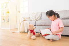 Children in the living room watching story book Royalty Free Stock Photography