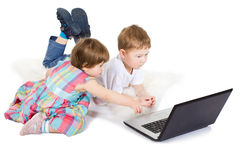 Children look cartoon films on the laptop Stock Photo