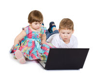Children look cartoon films on the laptop Royalty Free Stock Images