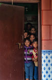 Children look out behind the door Royalty Free Stock Images