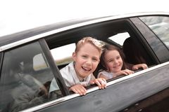 Children look out of the car window. Photo with copy space stock photography