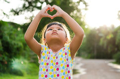 Children look pass hand heart. Children play happyness in nature and sunshine royalty free stock photos