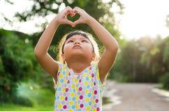 Children look pass hand heart Royalty Free Stock Photos