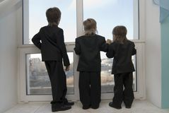 Children look in a window Royalty Free Stock Photo
