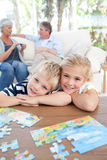 Children looking at the camera in the living room Royalty Free Stock Images