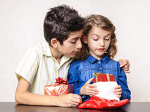 Children looking at Christmas present Royalty Free Stock Images