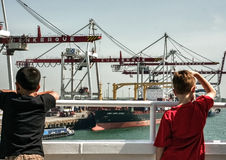 Children looking at container terminal at Dunkirk Royalty Free Stock Photography