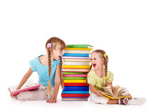 Children  looking at each other. Children  crying at each other near pile of book. Isolated Stock Photography