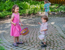 Children Looking for Easter Eggs Stock Image